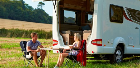 Man and women outside motorhome